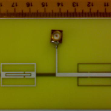 کوچکسازی آنتن دوقطبي مايکرواستريپي با استفاده از بارگذاري با NPMS